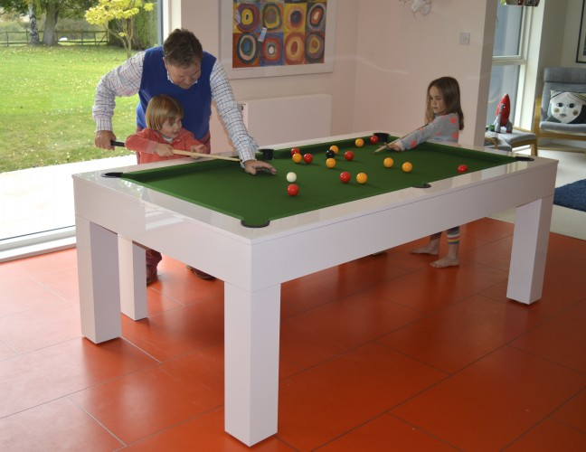Kingswood Aspen pool dining table being played on by family