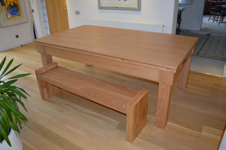 Kingswood oak pool dining table shown with covers on