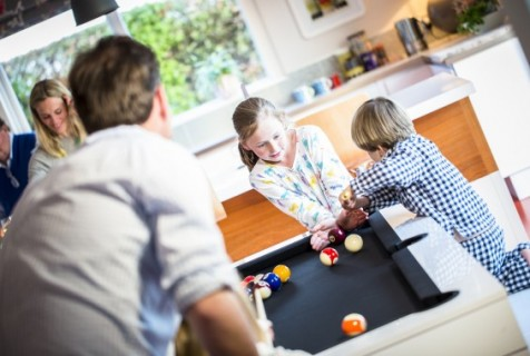 Pool dining tables for family spaces